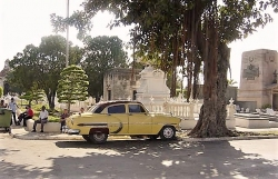 One of the many colorful old cars on the streets of Havana