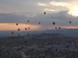 Balloons in pre-dawn sky in Cappadocia. Turkey