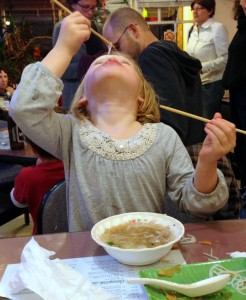 Addie eats noodles