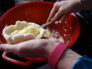 filling arepas with cheese