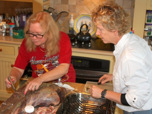 My daughter-in-law, Deb, and daughter, Robin. put the finishing touches on a leg of lamb at the farm.
