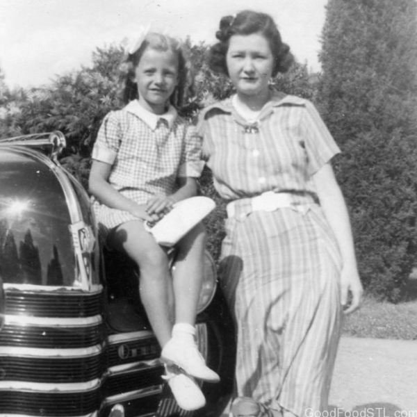 My mother Alvina Sullivan Carpenter and I with our old Oldsmobile.
