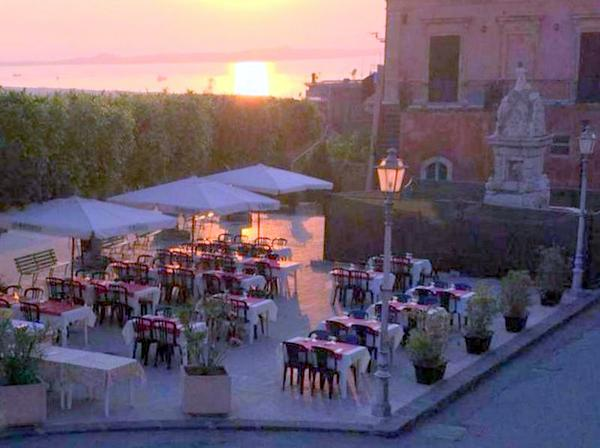 Sunset on the Plaza at Trattoria da Clara in Venetico, Sicily