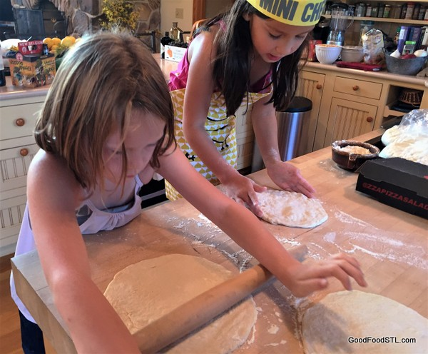 kids rolling pizza dough